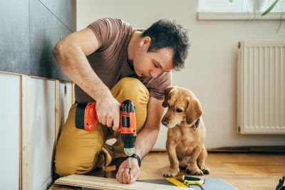 man with tools and dog