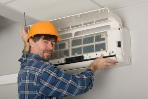 man checking air conditioner