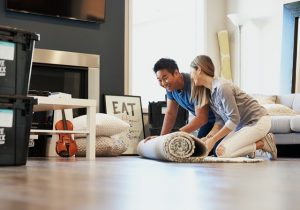 man and woman sitting on floor