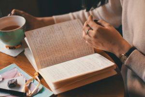 woman reading an d writing
