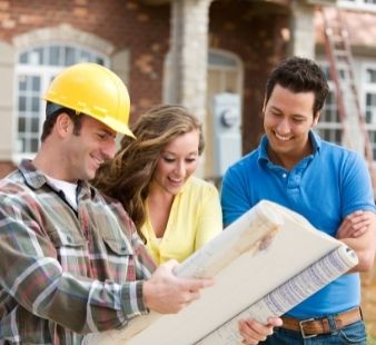 contractor talking with homeowners